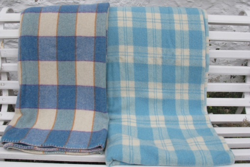 Soft blue and cream plaid blanket with a darker blue contrasting blanket alongside