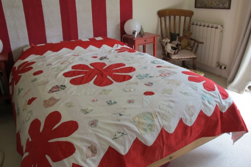 Naive Applique Coverlet on a bed