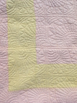 res_detail_of_front_pink_and_yellow_quilt