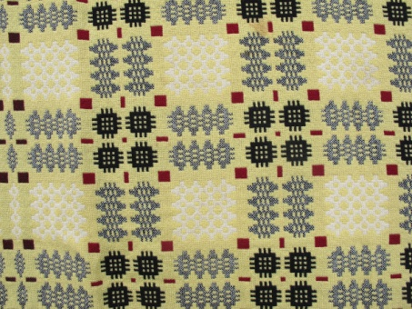 res_pattern_on_yellow_side_of_tapestry
